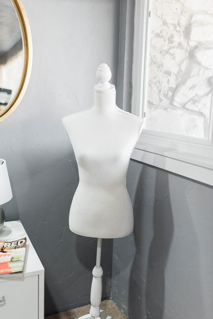 white mannequin in a sewing room