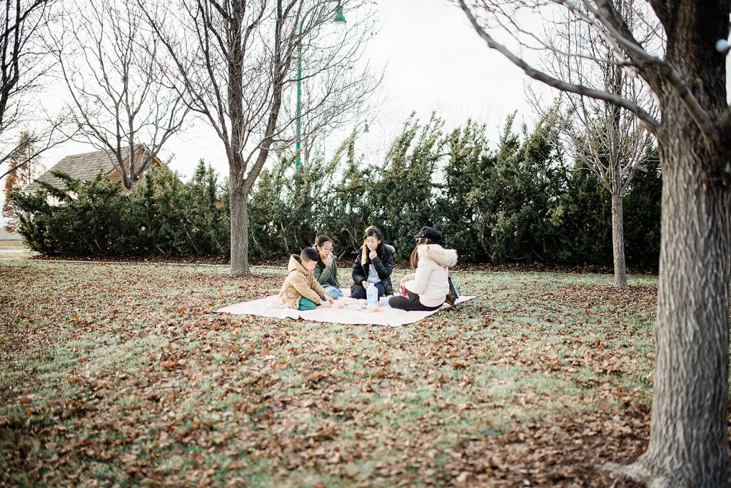 cute family having a picnic outside in the park