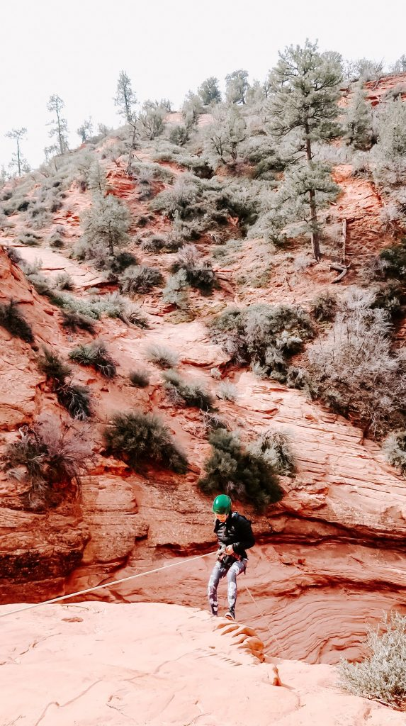 woman rappelling at zion
