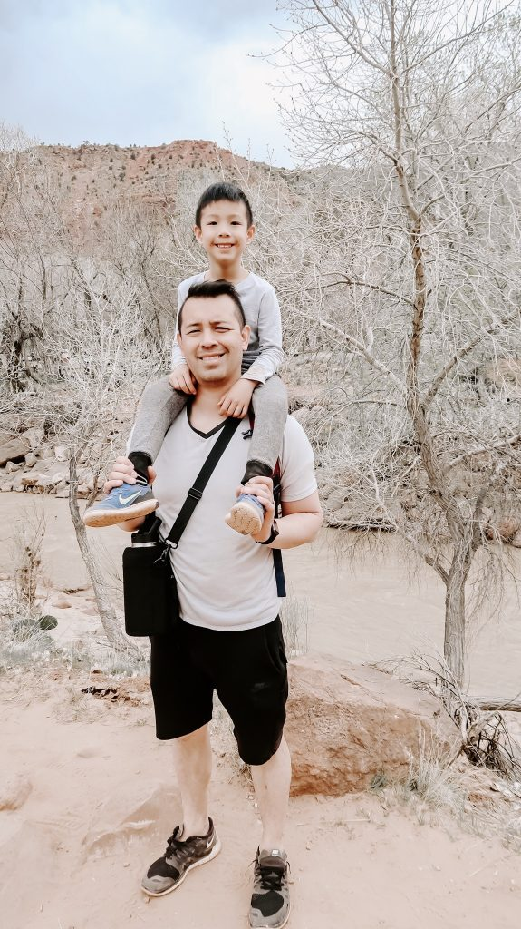 son on dad shoulder at Zion