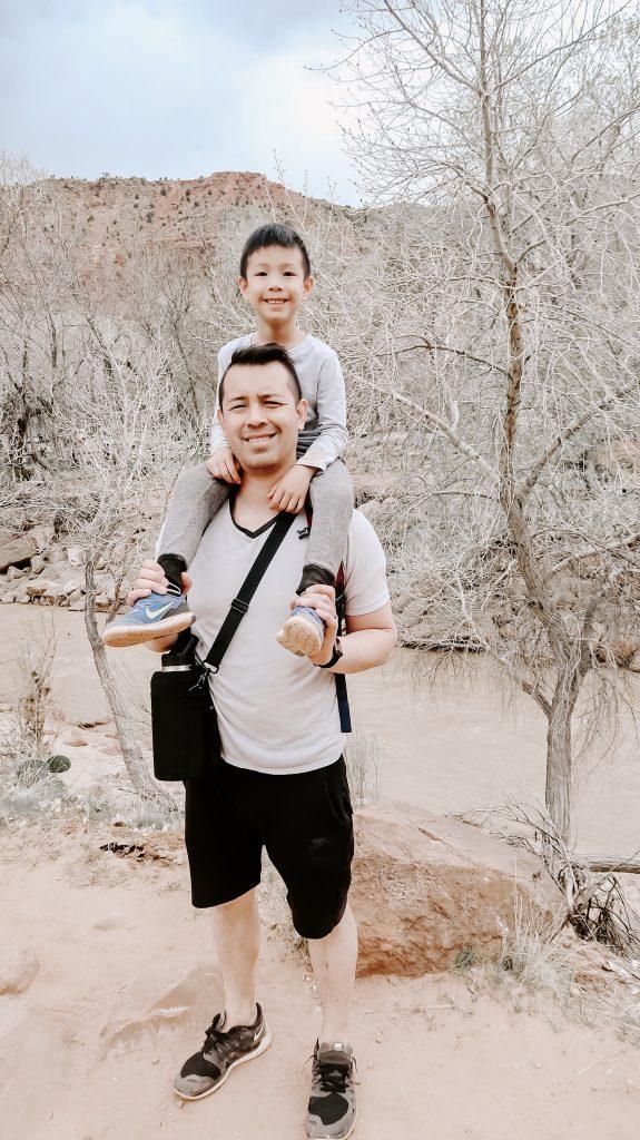 son on dad shoulder at Zion