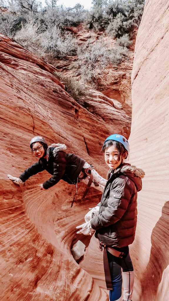 two girls rappelling at zion